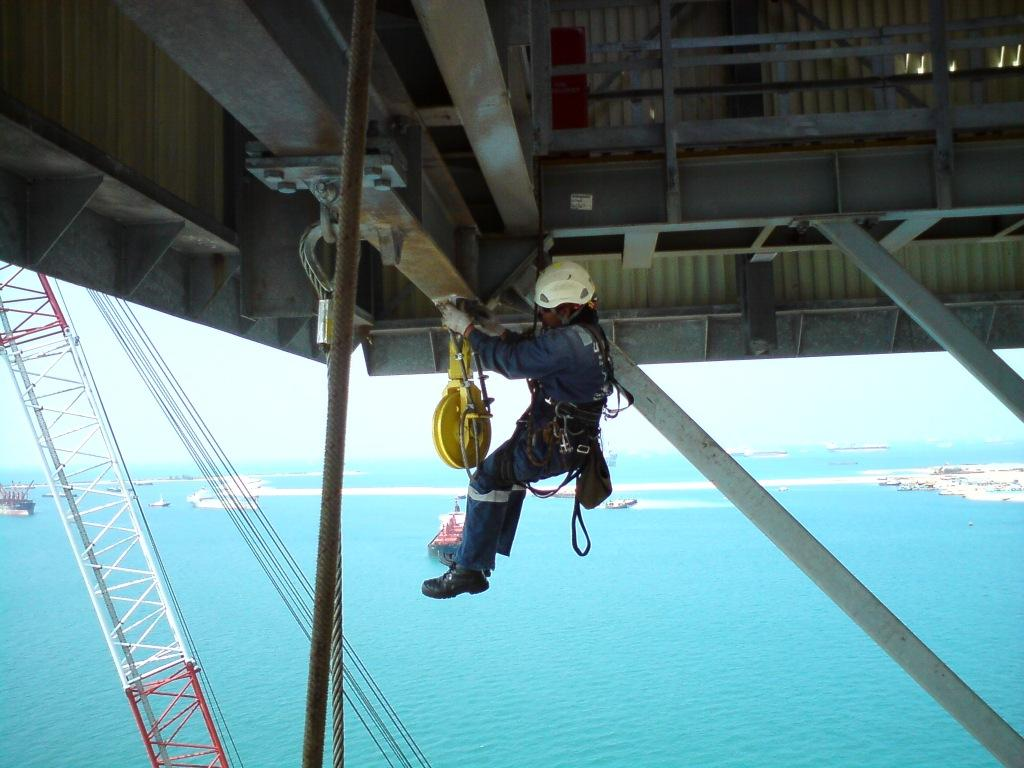 Man using industrial rope access in High Reliability Organisation
